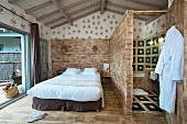 Rustic bedroom with ensuite bathroom in holiday cottage