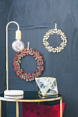 Hand-made craft paper Christmas wreaths on wall