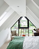 Attic bedroom with glazed gable end wall