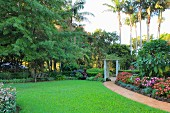 Exotic garden with lawn and tropical plants