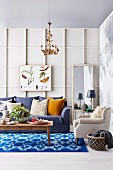 Living room in blue and white with wall covering made of decorative strips