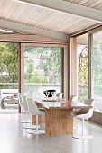 Modern dining room with window fronts and nature views