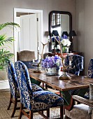 Upholstered chairs and antler candlesticks in dining room