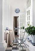 Round table and open French windows in bright loggia