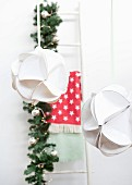 Christmas baubles hand-made from white paper plates