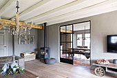 Industrial-style sliding door leading from living room into dining room