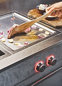 A modern hob for gentle, low-fat frying, grilling and warming