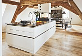 An elegant kitchen island under wooden beams