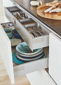 A kitchen island with open drawers