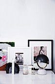 Table lamp, bookend and framed photos on desk