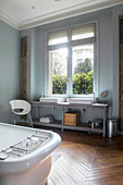 Large bathroom in period building with two sinks on long washstand