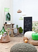 Vintage school desk and bench, blackboard and various crochet pouffes in child's bedroom