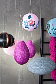 Lanterns and piñata suspended from ceiling
