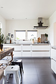 Festive decorations in white modern kitchen with grey floor tiles