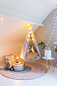 Hanging teepee chair in cosy corner of child's bedroom in shade s of grey and white