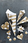 Hand-made Christmas decorations: 3D star, origami hearts and paper cones