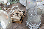Key tied to parcel of books amongst vintage-style drinking glasses