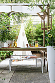 Set garden table on roofed terrace