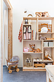 Shelves with compartments of various sizes in children's bedroom