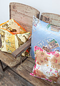 Holiday motifs on cushions on wood and metal bench