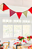 Homemade pennant chain over the festive table