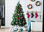 Colorfully decorated Christmas tree with pompoms and gifts