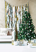 Garland with tinsel and tassels behind the Christmas tree