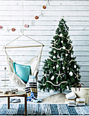 Decorated Christmas tree and hanging chair