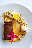 Chocolate, peanut and salted caramel torte with vanilla ice cream