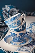 Stack of blue and white patterned china cups on saucer