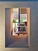 View through narrow aperture into kitchen