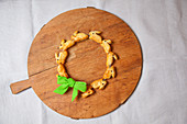 Wreath of pastry bunnies on round chopping board
