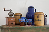 Old kitchen utensils and jam jars with fabric covers