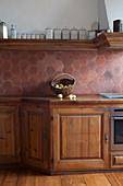 Splashback of honeycomb terracotta tiles in country-house kitchen
