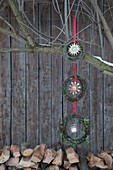 Garland of three wreaths with straw stars hung from tree