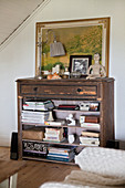 Old chest of drawers used as shelves without drawers in living room