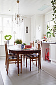 Antique wooden table in Scandinavian country-house kitchen