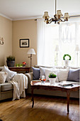 Grey sofa set and antique coffee table in classic living room