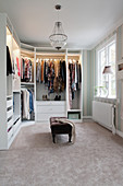 Large, elegant walk-in wardrobe with carpet