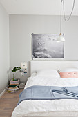 Poster of clouds above bed in pastel bedroom