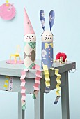 Easter bunny and clown made from eggs, toilet roll tubes and paper concertinas