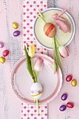 Tulips in eggs decorated wit washi tape decorating table
