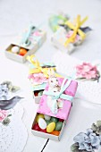 Sugar eggs in matchboxes covered in coloured paper as gifts