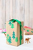 Gift wrapped in paper printed with Christmas trees
