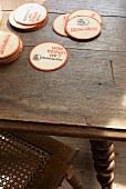 Round beer mats on oak table