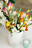 Bouquet of colourful freesias with blurred background