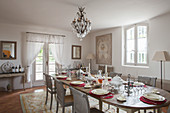 Festively set oval dining table in French-style dining table