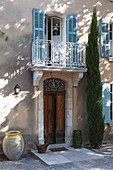 Balcony above old front door of Mediterranean country house
