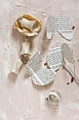 Vintage Christmas-tree decorations and wings made from book pages