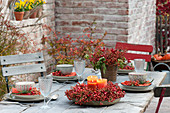Rosehip table decoration on the autumn terrace